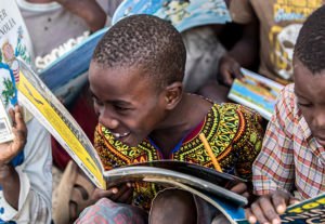 Happy learners are guided to better literacy by local mentors and trained staff.